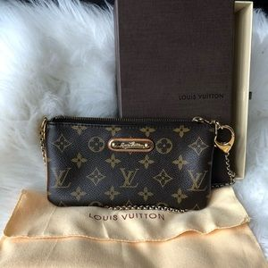 Louis Vuitton  milla clutch wallet mm